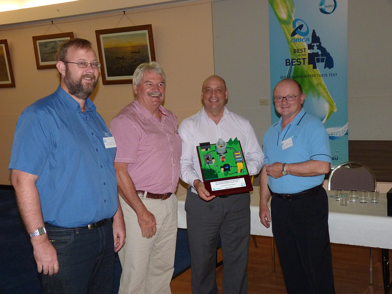 Orica Australia's George Lech (second from right) hands over the limited edition lego water treatment plant to Graham McKeon, Kevin Flannagan, and John Betts from Toowoomba Regional Council after winning the South West Queensland semi finals of the Best of the Best Queensland Water Taste Test.
