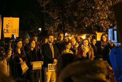 Attendees outside Balboa Park's House of France, Thursday, January 8, 2015, at a vigil for the victims of the Charlie Hebdo attack in Paris.