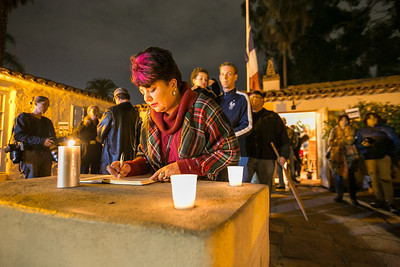 Sash Walker records her feelings outside Balboa Park's House of France, Thursday, January 8, 2015, at a vigil for the victims of the Charlie Hebdo attack in Paris.