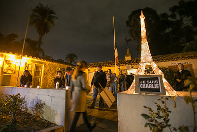 Attendees line up to record feelings outside Balboa Park's House of France, Thursday, January 8, 2015, at a vigil for the victims of the Charlie Hebdo attack in Paris.