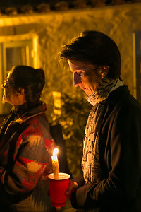 Ingrid Pasco, president of the House of France, addresses crowd outside Balboa Park's House of France, Thursday, January 8, 2015, at a vigil for the victims of the Charlie Hebdo attack in Paris.