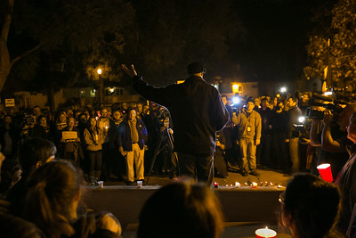 Anthony Hamm addresses crowd outside Balboa Park's House of France, Thursday, January 8, 2015, at a vigil for the victims of the Charlie Hebdo attack in Paris.