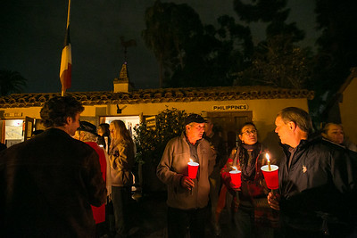 Andre Bordes, French Honorary Council in San Diego, Francoise Young and Gerald Gaucher outside Balboa Park's House of France, Thursday, January 8, 2015, at a vigil for the victims of the Charlie Hebdo attack in Paris.