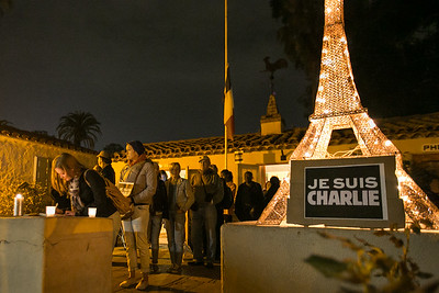 Attendees line up to record their feelings outside Balboa Park's House of France, Thursday, January 8, 2015, at a vigil for the victims of the Charlie Hebdo attack in Paris.