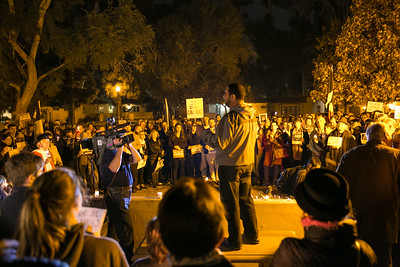 Imam Taha Hassane of the Islamic Center of San Diego addresses crowd outside Balboa Park's House of France, Thursday, January 8, 2015, at a vigil for the victims of the Charlie Hebdo attack in Paris.