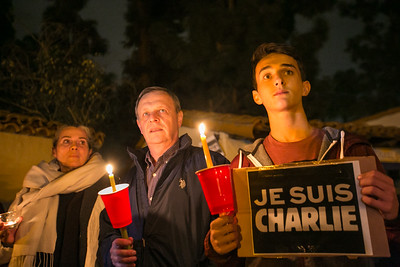 Marie-France, Gerald and Pierre Gaucher outside Balboa Park's House of France, Thursday, January 8, 2015, at a vigil for the victims of the Charlie Hebdo attack in Paris.