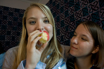 Gennie seems to be intrigued by Molly's sampling of the forbidden apple.