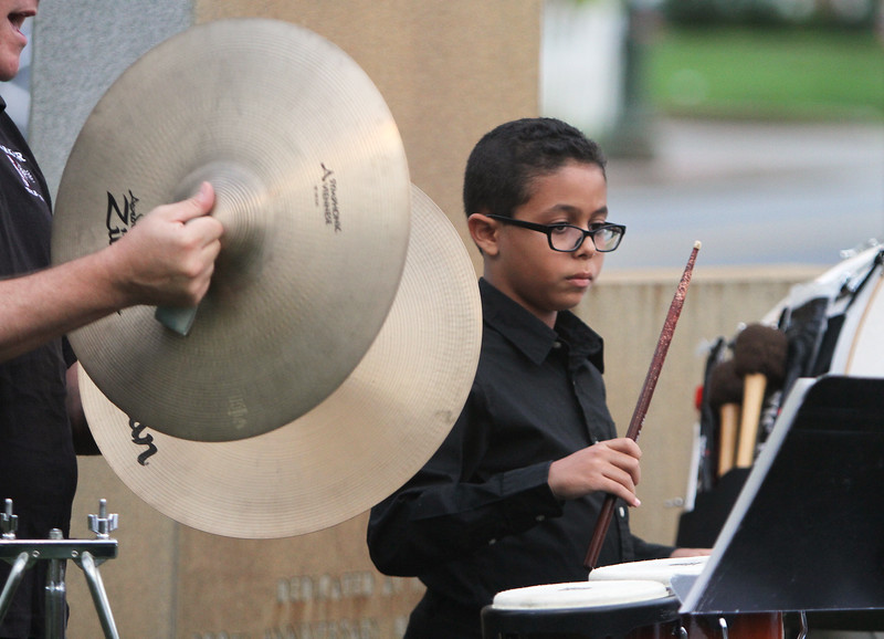 Chelmsford Community Band performs concert on Town Common in its Summer on the Common series. Gerom Boules, 11, of Chelmsford, one of several Parker Middle School students playing with the band, plays percussion. (SUN/Julia Malakie)