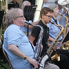 Chelmsford Community Band performs concert on Town Common in its Summer on the Common series. Robert Granville of Littleton on saxophone, left, and Parker Middle School student Tommy Parks, 13, of Chelmsford on tenor sax. (SUN/Julia Malakie)