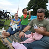 Chelmsford Community Band performs concert on Town Common in its Summer on the Common series.  Shannon and husband Shawn McNamee of Chelmsford enjoy the concert with their son Logan, 23 months old, and twin daughters Delaney, left, and Paisley, 8 months old. (SUN/Julia Malakie)