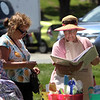 Saturday Farmers Market on Chelmsford Town Common. Tupperware lady Linda Bruen of Reading, left, and Claudia DeLucia of Chelmsford, one of the managers of the Farmers Market. (SUN/Julia Malakie) [NOTE: be sure to spell it DeLucia]