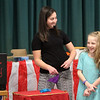 Chelmsford Winterfest. Volunteer Maddy Beary, 8, of Chelmsford, assists magician Abraca Abby (Abby Segal) at the Central Cooerative Nursery School Winter Carnival. (SUN/Julia Malakie)