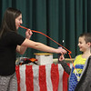 Chelmsford Winterfest. Volunteer Lucas Felzani, 9, of Chelmsford, assists magician Abraca Abby (Abby Segal) at the Central Cooerative Nursery School Winter Carnival. (SUN/Julia Malakie)