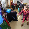 Chelmsford Winterfest. Samantha Lena, 7, of Chelmsford, tosses a football through a target at the Central Cooperative Nursery School Winter Carnival.  (SUN/Julia Malakie)