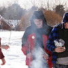 Chelmsford Winterfest. From left, Aidan Buckley, 14, Andrew Bogyo, 14, and Nick Vosnakis, 12, all of Chelmsford and members of Boy Scout Troop 75, toast marshmallows. (SUN/Julia Malakie)