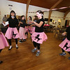 Chelmsford Winterfest. Girl Scout Troop 68172 members, from left front, Sritha Sithalam, 12, Naomi D'Souza, 12, Sam Kelepouris, 13, and Sicilia Campbell, 13, all of Chelmsford, dance between customers at the Pink Ladies Malt Shop at Central Baptist Church.  (SUN/Julia Malakie)