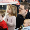 Chelmsford Winterfest. Tyler Leeds of Chelmsford with sons Thomas, 3, and Edward, 10 months, and Laura Sloan, 4, also of Chelmsford (no relation), watch magician Abraca Abby at the Central Cooerative Nursery School Winter Carnival. (SUN/Julia Malakie)