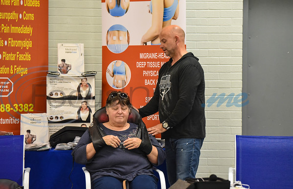 Judy Faye of Rusk tries out a massage product at the Cherokee Craft & Trade Fair in Jacksonville on Saturday, March 14.  More than 30 vendors were on hand at the Ruby Ballroom for the event.