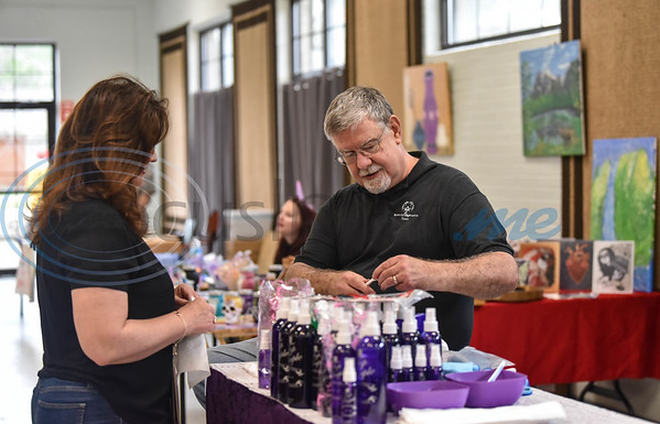 A Top Purple vendor does a demonstration at the Cherokee Craft & Trade Fair in Jacksonville on Saturday, March 14. The event takes place monthly at the Ruby Ballroom wit the exception of January and June.