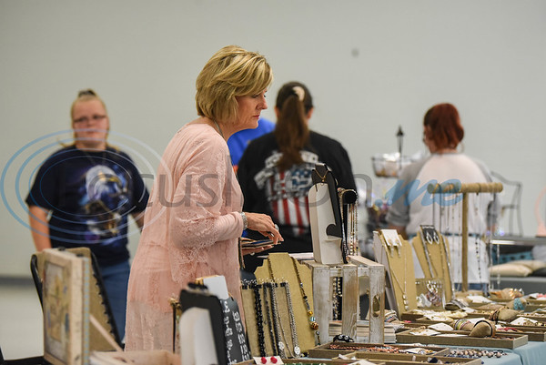 A fair goer checks out jewelry at the Cherokee Craft & Trade Fair in Jacksonville on Saturday, March 14.
