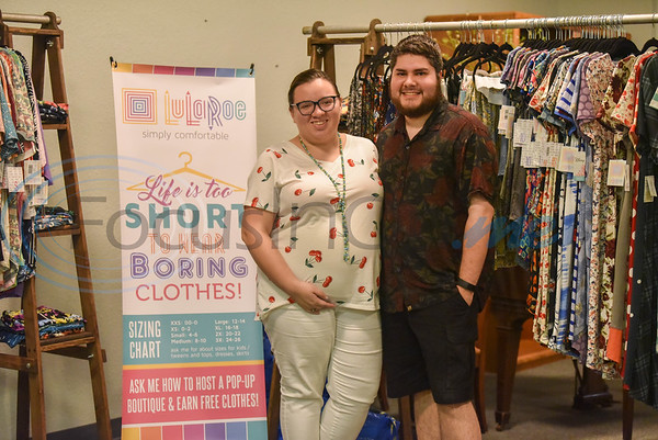 LuLaRoe vendors Leah Sanchez (left) and husband Bryan Sanchez smile for a photo while working their booth at the Cherokee Craft & Trade Fair. The event took place on Saturday, March 14 at the Ruby Ballroom in Jacksonville.