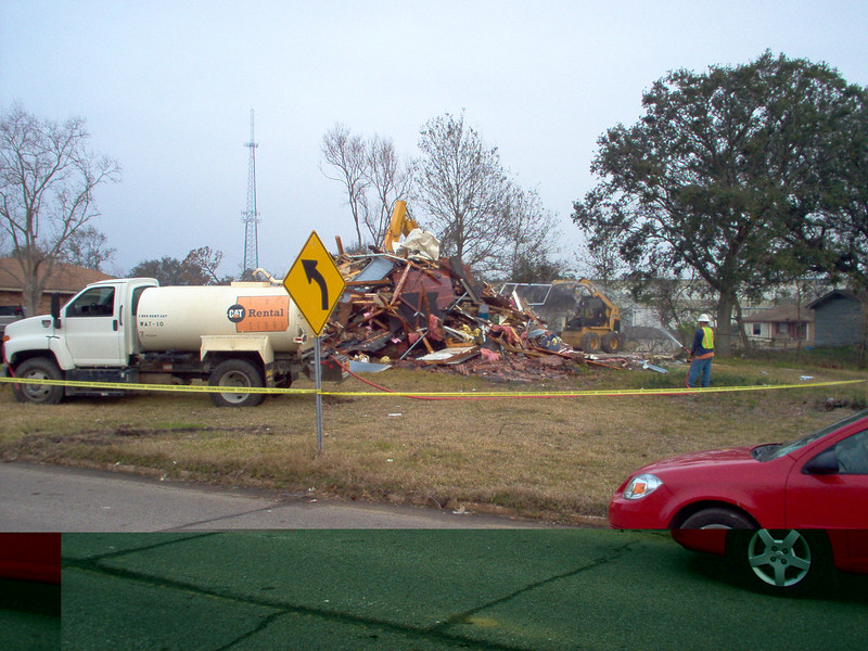 Another view of the pile.  Notice the water tanker truck and the guy hosing down debris to keep the dust down.