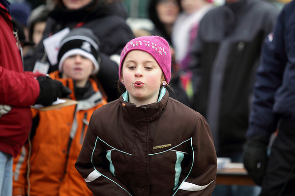 Record-Eagle/Keith King<br /> Lauren Collins, 8, of Cadillac, competes in the Frozen Pit Spit contest Saturday, February 19, 2011 during the Cherry Capital Winter Wow!Fest.