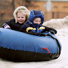 Record-Eagle/Keith King<br /> Paige Bell, left, 5, of Traverse City, and her twin brother, Michael Bell, ride on a snow tube Saturday, February 19, 2011 during the Cherry Capital Winter Wow!Fest.