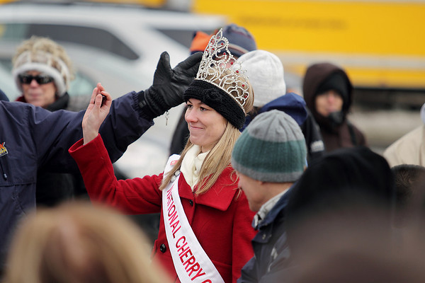 Record-Eagle/Keith King<br /> Maria LaCross, the 2010-2011 National Cherry Queen, waves to spectators Saturday, February 19, 2011 prior to participating in the Frozen Pit Spit contest during the Cherry Capital Winter Wow!Fest.