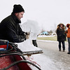 Record-Eagle/Keith King<br /> Derek Maxfield, of Grand Rapids, also with the Food Network's 'Ice Brigade,' carves a tiger out of ice Saturday, February 19, 2011 at the Grand Traverse Resort & Spa in Acme during the Cherry Capital Winter Wow!Fest.