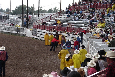 Waiting for the action.  It was my luck to arrive on the only day in July that it rained in Cheyenne, Wyoming - notice all the slickers.