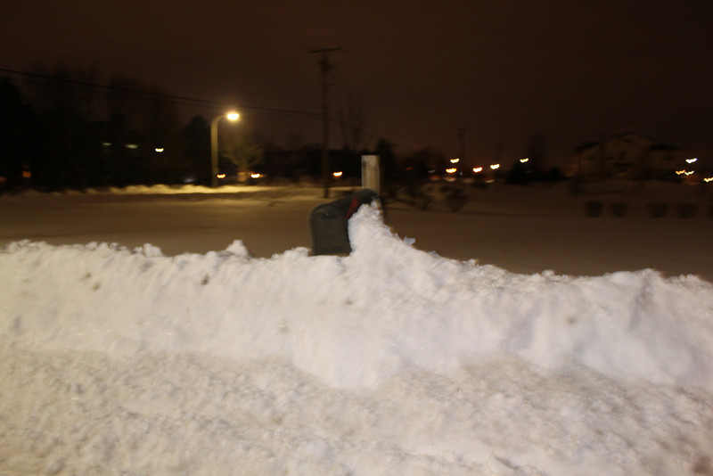 our mailbox partially covered by the precipitation.