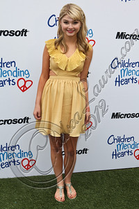 PACIFIC PALISADES, CA - APRIL 22:  Actress Stefanie Scott arrives at The Children Mending Hearts 4th annual spring benefit on April 22, 2012 in Pacific Palisades, California.  (Photo by Chelsea Lauren/Getty Images)