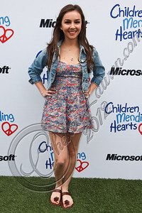 PACIFIC PALISADES, CA - APRIL 22:  Actress Lexi Ainsworth arrives at The Children Mending Hearts 4th annual spring benefit on April 22, 2012 in Pacific Palisades, California.  (Photo by Chelsea Lauren/Getty Images)