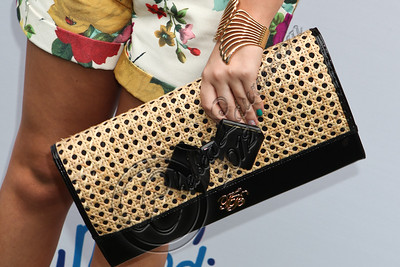 PACIFIC PALISADES, CA - APRIL 22:  Actress Jennifer Veal (clutch detail) arrives at The Children Mending Hearts 4th annual spring benefit on April 22, 2012 in Pacific Palisades, California.  (Photo by Chelsea Lauren/Getty Images)
