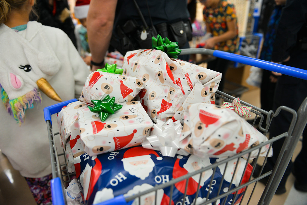 "Justin Sheely | The Sheridan Press	<br /> Wrapped presents are seen in a shopping cart during ""Shop with a Cop"" at Walmart Saturday, Dec. 9, 2017. Walmart donated $2000 to the Shop with a Cop program, which helps children buy holiday gifts for their families."