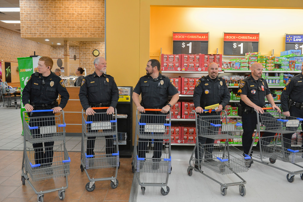 "Justin Sheely | The Sheridan Press	<br /> Members of the Sheridan Police Department wait with carts during ""Shop with a Cop"" at Walmart Saturday, Dec. 9, 2017. Walmart donated $2000 to the Shop with a Cop program, which helps children buy holiday gifts for their families."