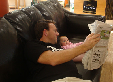 Isla checks her shares while I look to see if JoDa's birth has made the papers.