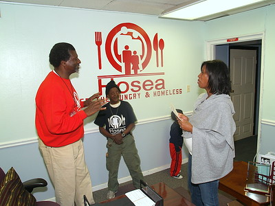"""(L) Actor, Afemo Omilami, Co-Director of """"Hosea Feed The Hungry and Homeless"""" chats with (R) Monique Evans, President & Founder of The Children's Pride Foundation."""