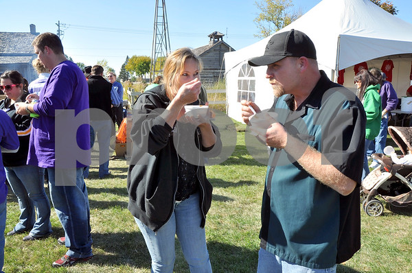 -Messenger photo by Joe Sutter<br /> <br /> Karen and William Rysavy, of Lytton, try their first bowl of chili at the annual Fort Dodge Chili-Lover's cookoff. There were 14 contestants in all offer their savory soup for the public's approval.