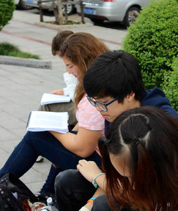 Felicia Escandon (in orange tie-dye) with Concordia International School Shanghai students reading prevalent historical articles on a break in Zhangjiajie. The articles included topics such as Lin Zexu, Mao Zedong, the Great Leap Forward, John Rabe, and Nanking Safety Zone.