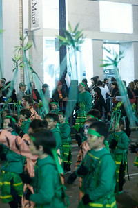 Schoolkids dressed as bamboo