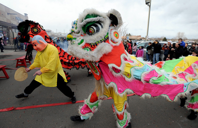 """Doug Sexton, playing the Happy Buddha, leads the lions on their quest.<br /> Members of the Tai Kung Ha Holistic Fitness Center performed a Chinese New Year Lion Dance at Pacific Ocean II Marketplace in Broomfield on Saturday.<br /> For more photos and a video, go to  <a href=""""http://www.dailycamera.com"""">http://www.dailycamera.com</a>.<br /> Cliff Grassmick / February10, 2013"""