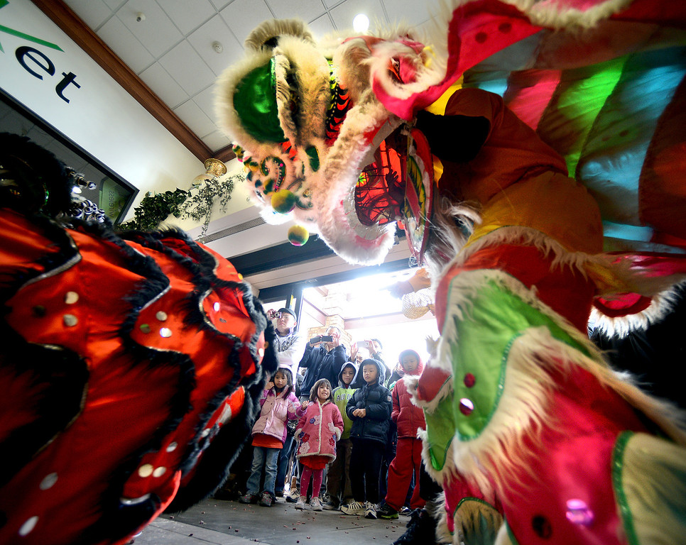 """The crowd followed the lions inside the marketplace.<br /> Members of the Tai Kung Ha Holistic Fitness Center performed a Chinese New Year Lion Dance at Pacific Ocean II Marketplace in Broomfield on Saturday.<br /> For more photos and a video, go to  <a href=""""http://www.dailycamera.com"""">http://www.dailycamera.com</a>.<br /> Cliff Grassmick / February10, 2013"""