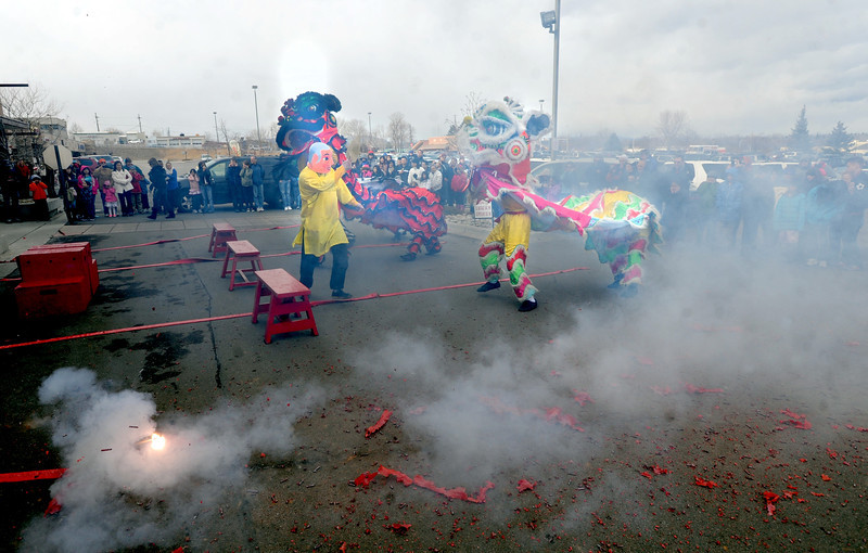 """Hundreds of firecrackers exploding started the lion dance.<br /> Members of the Tai Kung Ha Holistic Fitness Center performed a Chinese New Year Lion Dance at Pacific Ocean II Marketplace in Broomfield on Saturday.<br /> For more photos and a video, go to  <a href=""""http://www.dailycamera.com"""">http://www.dailycamera.com</a>.<br /> Cliff Grassmick / February10, 2013"""