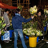 Lots of girls trying to sell flowers on new year eve