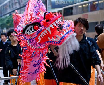 A Dragon Dance team walking across the street
