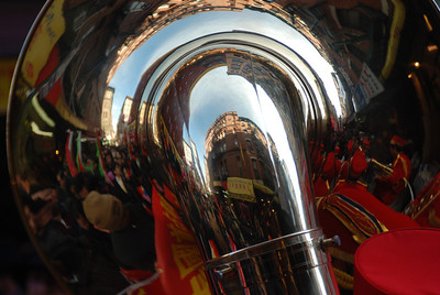 Building and crowd reflected in a sousaphone at the 2012 Chinese Lunar New Year parade in NYC