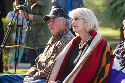 Councilman Ted Dosh and Oklahoma Tourism Director Deby Snodgras listen to the speakers at the grand opening ceremony.