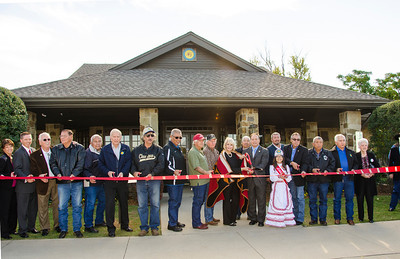 A ribbon cutting and cultural activities were part of the grand opening celebration at the Choctaw Tourism Information Center, held on Oct. 25 in Colbert. Cutting the ribbon are Assistant Chief Batton, the Choctaw Tribal Council, State Tourism Director Deby Snodgrass, Director of the center Lana Sleeper, as well as other state, county and city officials.